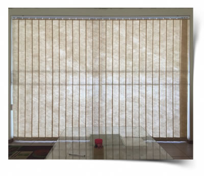 A 127mm vertical blind slided to cover the sliding door and turned in the closed position.
