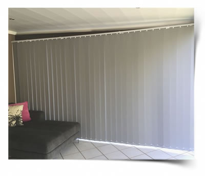 A Vertical blind close and slid to fill the whole sliding door
