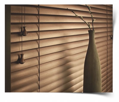 A Wooden venetian blind that is closed and blends in with the decor.